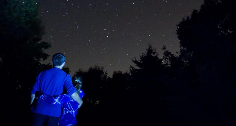 Trevor Jones - Amatuer Astrophotographer standing under the stars with his fiance Ashley.