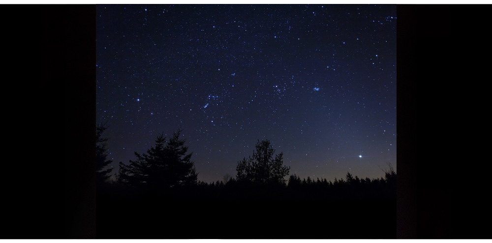 Wide-field image of winter constellations Orion and Taurus