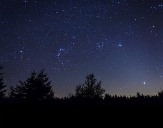 the night sky with the Pleiades star cluster visible