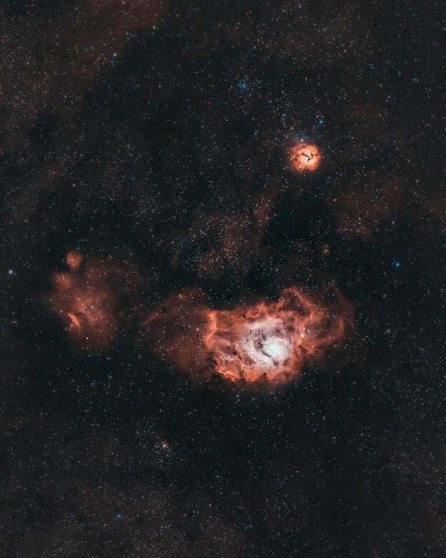 Lagoon and Trifid Nebula by Josh Wilson